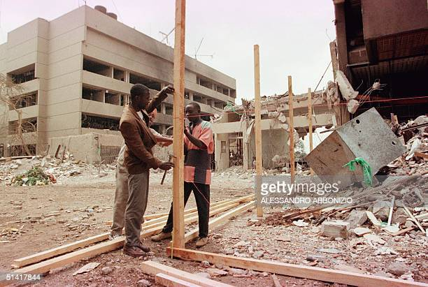 Construction workers prepare to fence off damaged shops and offices 17 August at the scene of a bomb blast that killed 247 people in Nairobi last...
