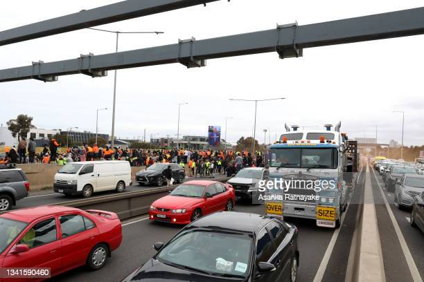 Construction workers protest along the West Gate Freeway on September 21, 2021 in Melbourne, Australia. Protests started outside the headquarters of...