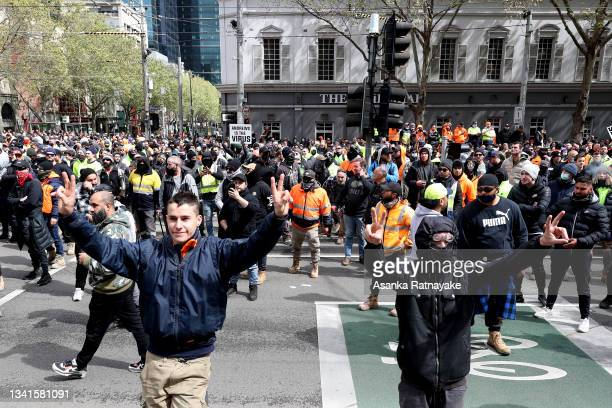 Construction workers protest through Melbourne's CBD on September 21, 2021 in Melbourne, Australia. Protests started outside the headquarters of the...