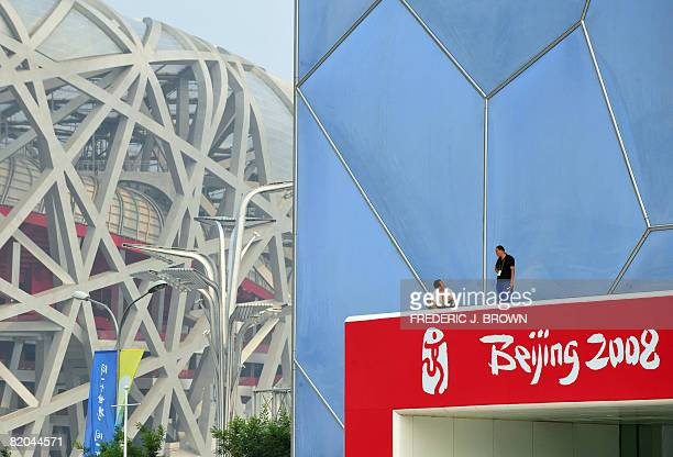 Construction workers put the finishing touches on the exterior of the National Aquatics Centre also known as the Water Cube on July 23 2008 in...
