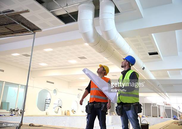 construction workers reading blueprints - ventilator stock pictures, royalty-free photos & images