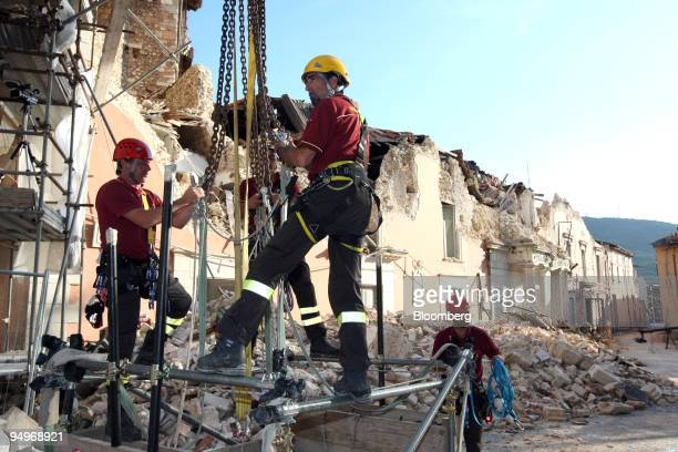 Construction workers rebuild a government building destroyed by an April earthquake in L'Aquila, Italy, on Wednesday, July 8, 2009. Group of Eight...