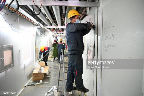 Construction workers renovate the Xiaotangshan Hospital which was built to treat patients infected with severe acute respiratory syndrome in 2003 on...