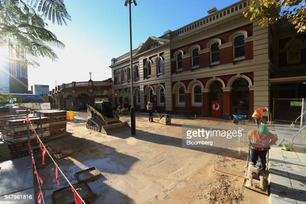 Construction workers repave an area at Perth railway station in the central business district of Perth Australia on Wednesday April 11 2018 Australia...