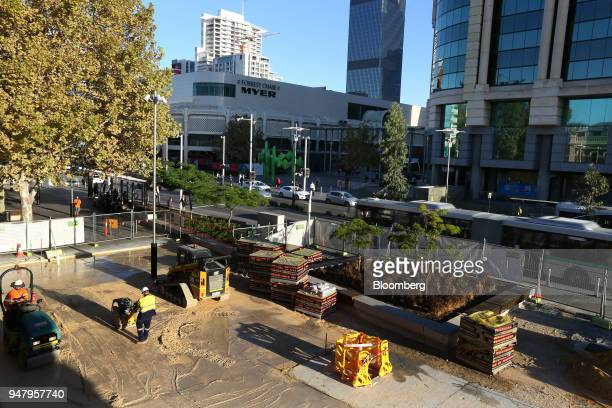 Construction workers repave an area of the central business district of Perth Australia on Wednesday April 11 2018 Australia is scheduled to release...