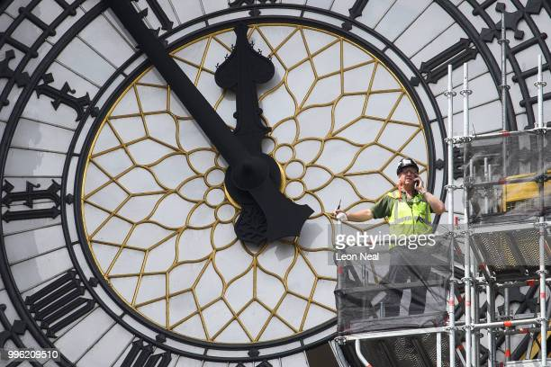 Construction workers replace panes of glass in the clockface of Queen Elizabeth Tower commonly known as Big Ben on July 11 2018 in London England The...