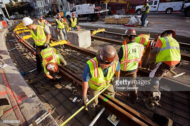CONTENT] Construction workers replacing a section of tracks of the San Francisco Municipal Railway on Duboce Street This is a curved section equipped...