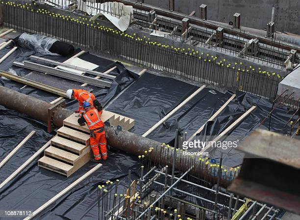 Construction workers secure a temporary staircase at the Balfour Beatty development at Blackfriars Bridge station in London UK on Friday Feb 4 2011...