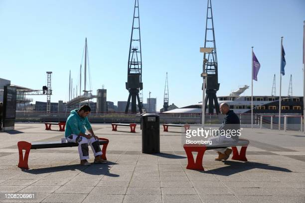 Construction workers sit at a safe social distance as they take a break in London, U.K., on Wednesday, March 25, 2020. Constructionworkers have been...