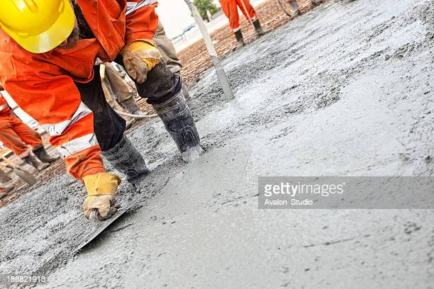 Construction workers smooth the concrete