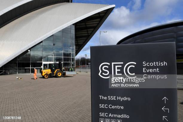 Construction workers some wearing face masks work at the Scottish Events Campus which includes the SSE Hydro in Glasgow on April 1 as it is...