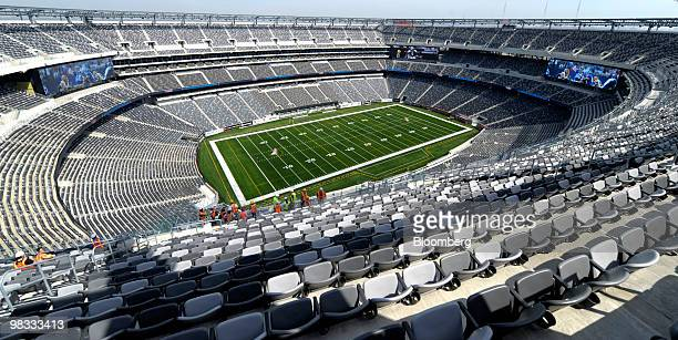 Construction workers stand in the new Meadowlands Stadium in East Rutherford New Jersey US Thursday April 8 2010 The new stadium will be home to both...