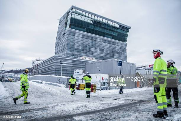 Construction workers stand near the building site of the Edvard Munch-museum in Oslo, Norway, on Tuesday, Feb. 5, 2019. Norway will release its...