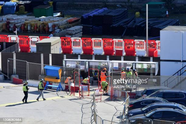 Construction workers take a break in the smoking area at Nine Elms in south London on March 24 as Britain's Chancellor of the Duchy of Lancaster...