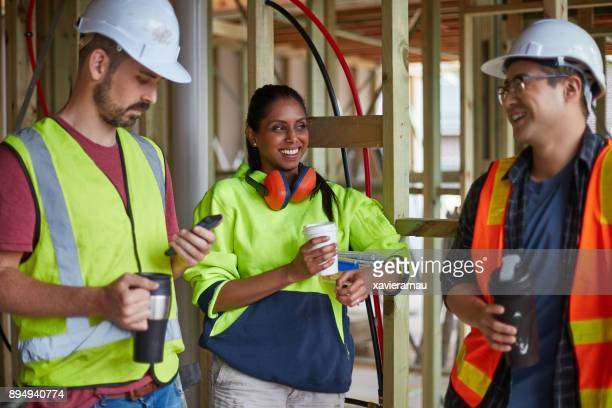 construction workers talking in coffee break - coffee break stock pictures, royalty-free photos & images