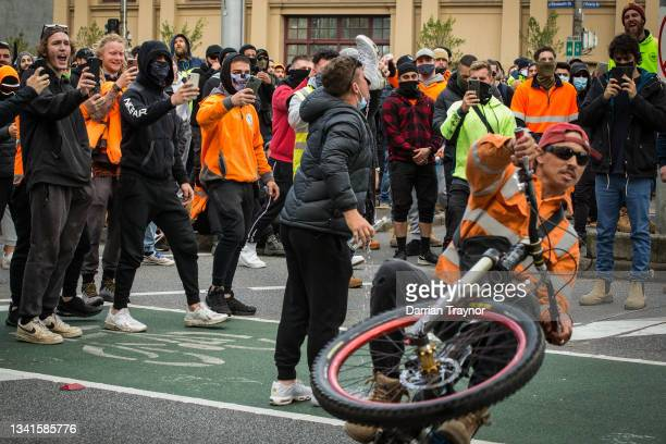 Construction workers taunt Police in Elizabeth street on September 21, 2021 in Melbourne, Australia. Protests started outside the headquarters of the...