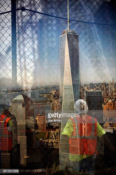 Construction workers through a security screen that shows the finished One World Trade Center at the World Trade Center Complex Joe Amon The Denver...