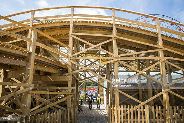 Construction workers walk beneath the Scenic Railway ride at Dreamland amusement park on June 18 2015 in Margate England Dreamland is considered to...