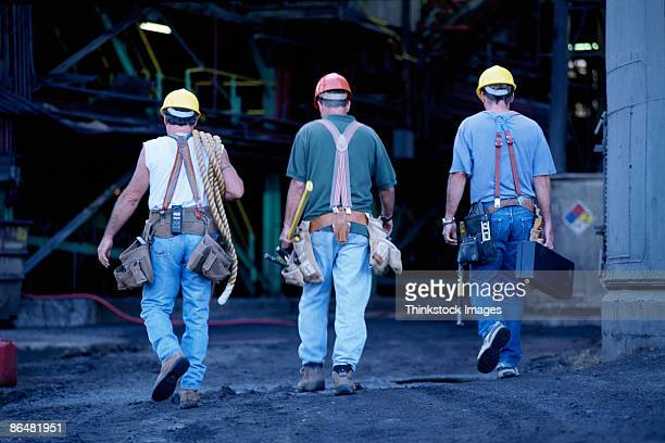 Construction workers walking away