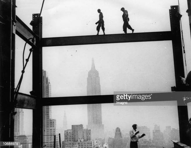 Construction workers walking on the scaffolding of the RCA building New York USA Photograph Around 1934