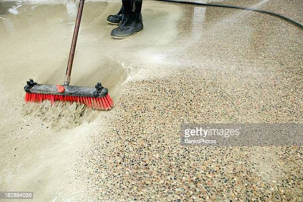 Construction Workers Washing Concrete Patio to Expose Aggregate