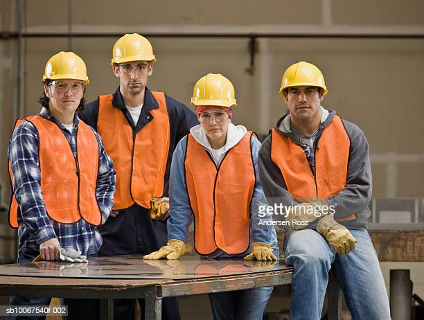 construction workers wearing hard hat and safety vest, portrait - four people stock pictures, royalty-free photos & images