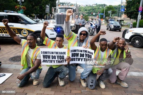 Construction workers who walked off the job join a protest a day after the funeral of Antwon Rose II on June 26 2018 in Pittsburgh Pennsylvania Rose...