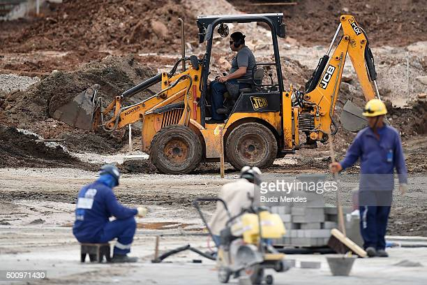 Construction workers work in preparation for the Rio 2016 Olympics at Olympic Park on December 11 2015 in Rio de Janeiro Brazil