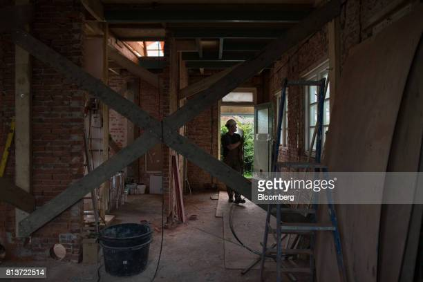 Construction workers work inside the uninhabitable house affected by fracking owned by Ebe Treffers in Wirdum Groningen Netherlands on Thursday June...