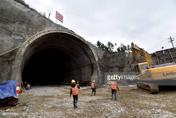 Construction workers work to build Tencent's biggest data center in the mountainous area of the hinterland on March 13 2018 in Anshun Guizhou...
