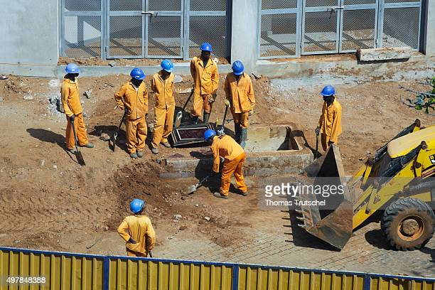 Construction workers working at a construction site on November 19 2015 in Maputo Mozambique
