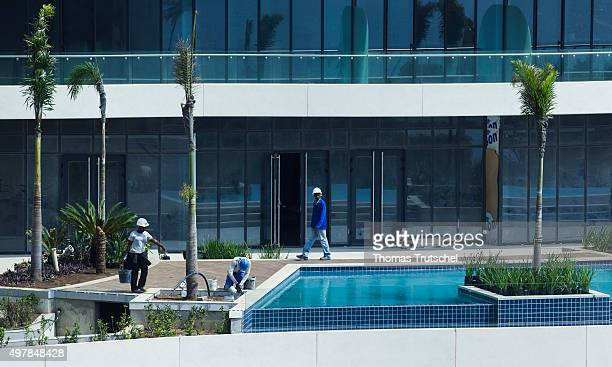 Construction workers working at a pool on the construction site of a luxury hotel on November 19 2015 in Maputo Mozambique