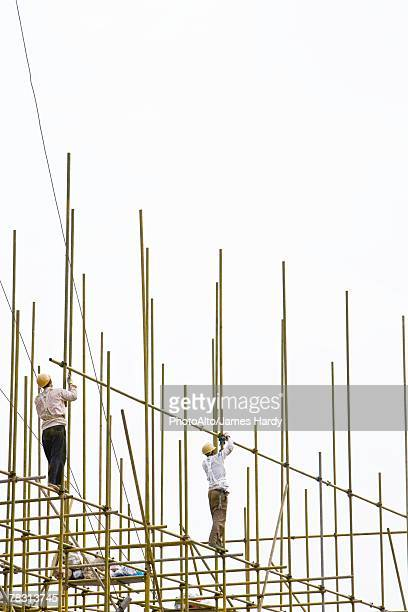 Construction workers working at construction site