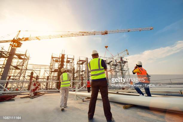construction workers working at site - construction site stock pictures, royalty-free photos & images