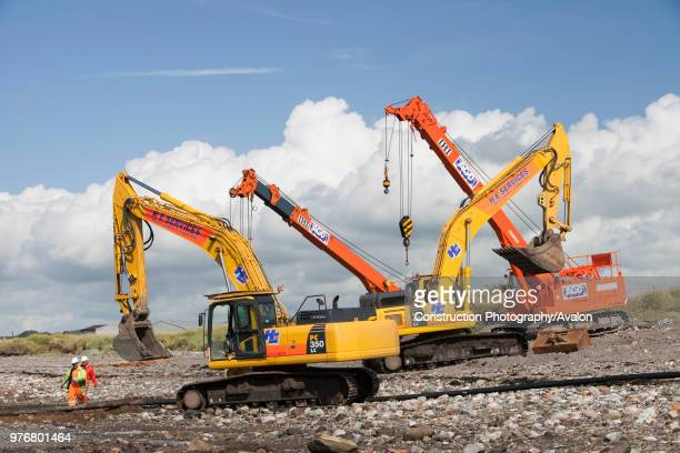 Construction workers working on the foreshore of the Solway Firth near Workington, installing the power cable that will carry the electricity from...