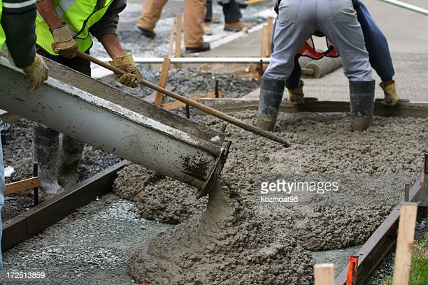 construction workers working on the sidewalk - cement stock pictures, royalty-free photos & images