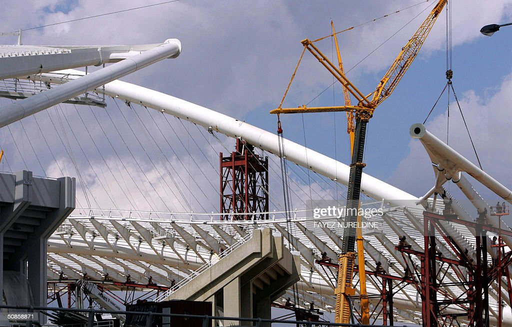 Construction works are going on, on both of the eastern and western arches of the main Olympic stadium roof in Athens on19 May 2004. The eastern arch designed to support the roof of the stadium, as the western one moved to its position some week ago.