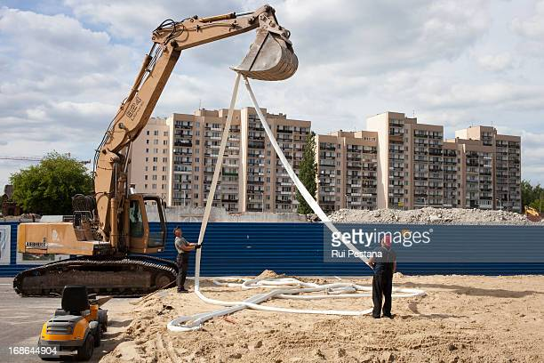 Construction works unfold in the booming neighbourhood of Praga, in Warsaw. At Praga district in Warsaw. June 2012
