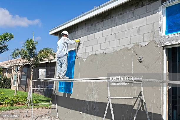 construction:real situation, stucco contractor - stucco stock pictures, royalty-free photos & images