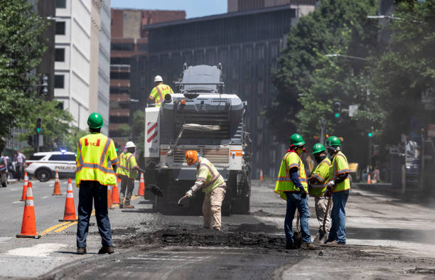DC: Workers Repave Roadways In Washington, DC