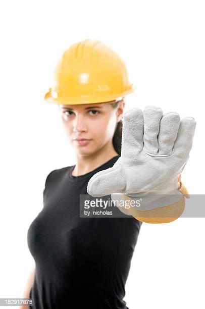 Constructor Frau mit hand heben, STOP-Schild