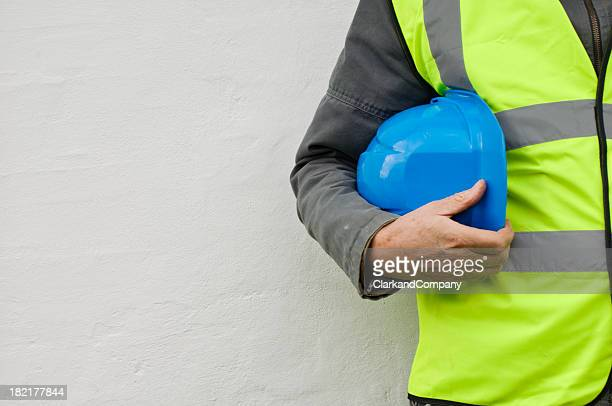Constuction Worker With Hi-Visibilty Safety Jacket and Hard Hat.