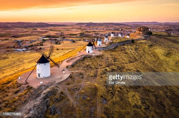 consuegra windmills at sunset. castilla la mancha, spain - toledo spain stock pictures, royalty-free photos & images