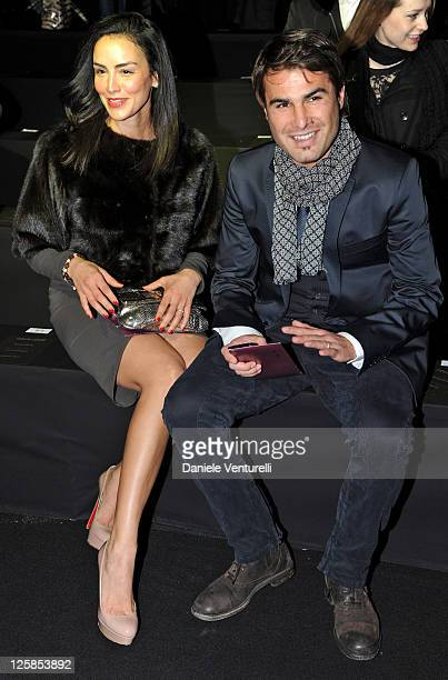 Consuelo Matos Gomez and Adrian Mutu attend the Roberto Cavalli Fashion Show as part of Milan Fashion Week Menswear A/W 2011 on January 15 2011 in...