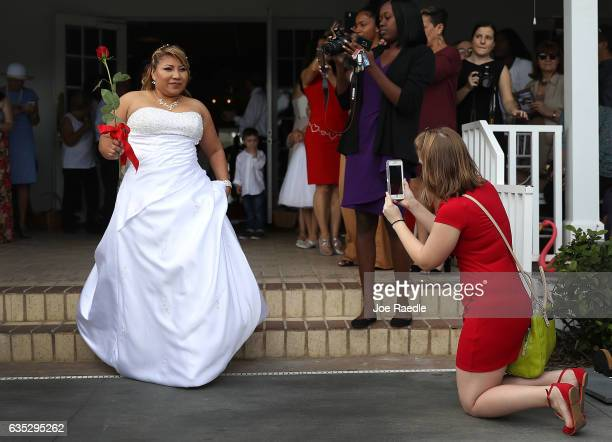 Consuelo Ramos arrives for a group Valentine's day wedding at the National Croquet Center on February 14 2017 in West Palm Beach Florida...