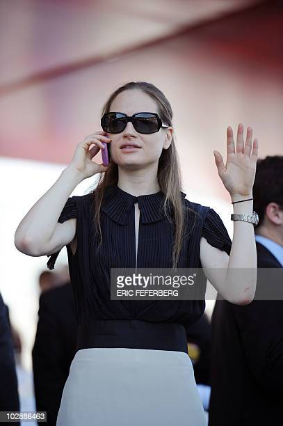 Consuelo Remmert, half-sister of French First Lady Carla Bruni-Sarkozy, waits to attend the annual Bastille Day military parade in Paris July 14,...