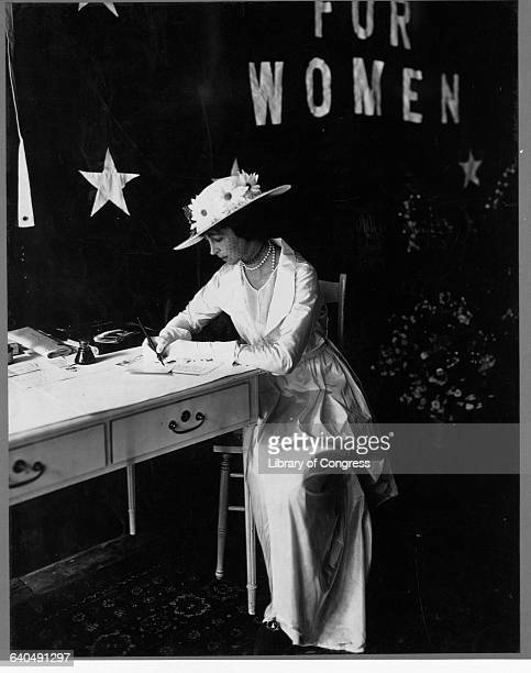 Consuelo Vanderbilt Balsan signs a petition to join a suffrage group in 1914 She wears an evening dress and hat