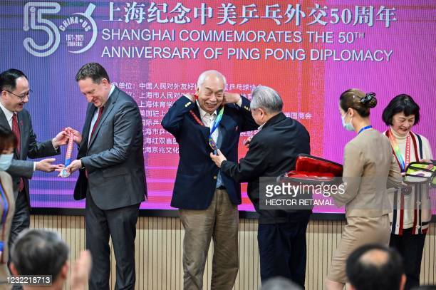 """Consul General in Shanghai James Heller with former Chinese table tennis players and """"Ping-pong diplomacy"""" participants Zhang Xielin and Zheng Minzhi..."""