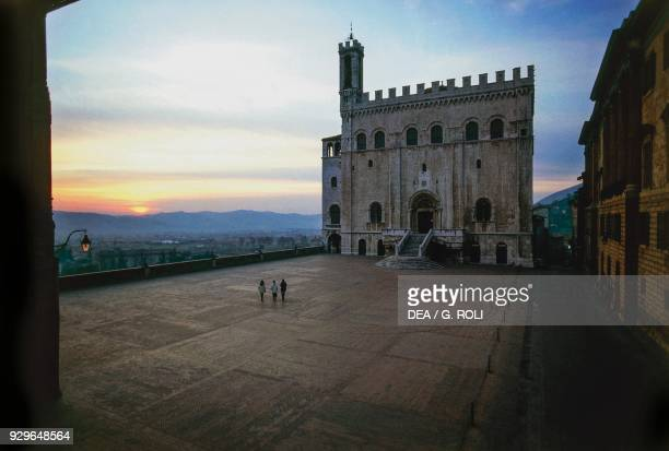 Consuls palace 13321349 and Piazza Grande sunset Gubbio Umbria Italy 14th century