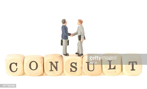 consult - abstract image with handshake